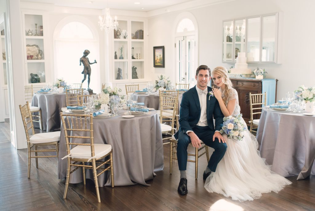 Bride & Groom at Wedding Venue Sitting with Tables Capen House | Anna Christine Events Orlando Central Florida Wedding Planner