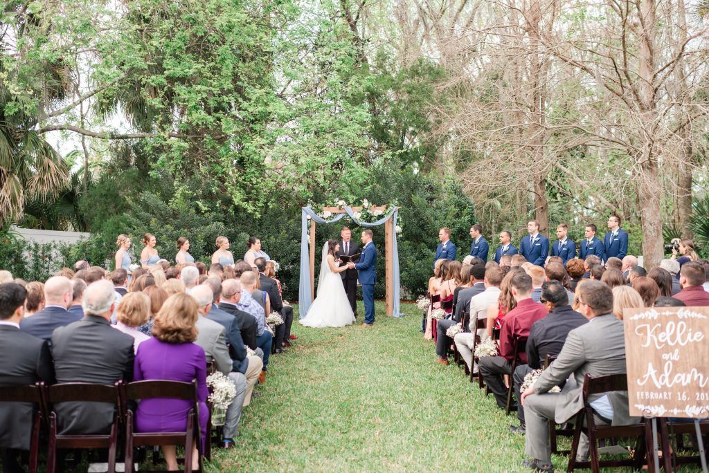 Bride & Groom Outdoor Ceremony Reverend Glynn Ferguson Sensational Ceremonies Arbor Archway | Blue & White Wedding Luxmore Grand Estate Anna Christine Events