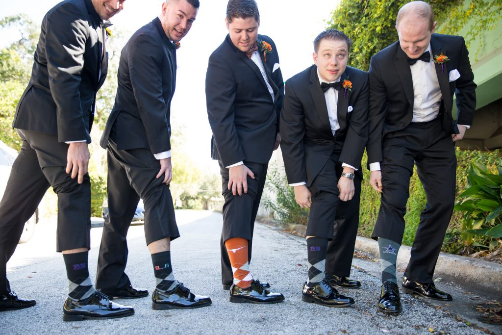 Groom Groomsmen Matching Socks Sports Teams Football | Classic Purple & Orange Wedding Football Texas Longhorns Sports Lake Lucerne Courtyard Anna Christine Events Orlando Kathy Thomas Photography