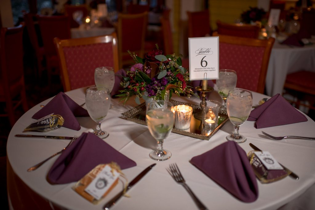 Table Setting Table Number Memories | Courtyard at Lake Lucerne Reception | Classic Purple & Orange Wedding Football Texas Longhorns Sports Lake Lucerne Courtyard Anna Christine Events Orlando Kathy Thomas Photography