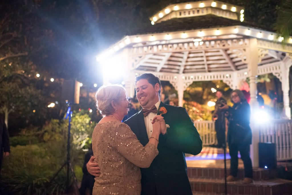 Mother Son Dance The Bay Kings Band | The Courtyard at Lake Lucerne Classic Purple & Orange Wedding Football Texas Longhorns Sports Lake Lucerne Courtyard Anna Christine Events Orlando Kathy Thomas Photography