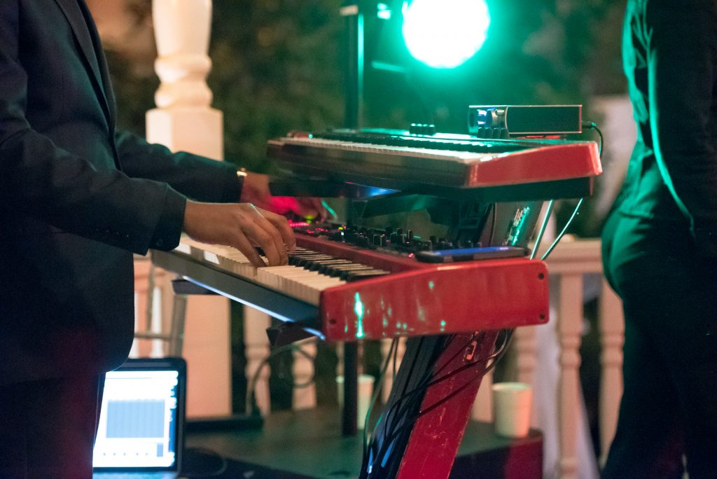 The Bay Kings Band Live Band Piano | The Courtyard at Lake Lucerne Classic Purple & Orange Wedding Football Texas Longhorns Sports Lake Lucerne Courtyard Anna Christine Events Orlando Kathy Thomas Photography