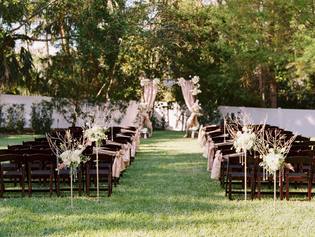 Aisle Outdoor Ceremony Archway | Travel Inspired Themed Glamorous Gold & White Wedding Luxmore Grande Estate Anna Christine Events Justin DeMutiis Photography