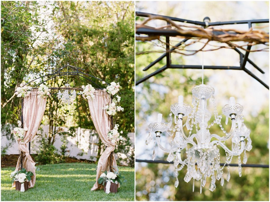 Arbor Archway Chandelier Hanging Outdoor Ceremony | Travel Inspired Themed Glamorous Gold & White Wedding Luxmore Grande Estate Anna Christine Events Justin DeMutiis Photography