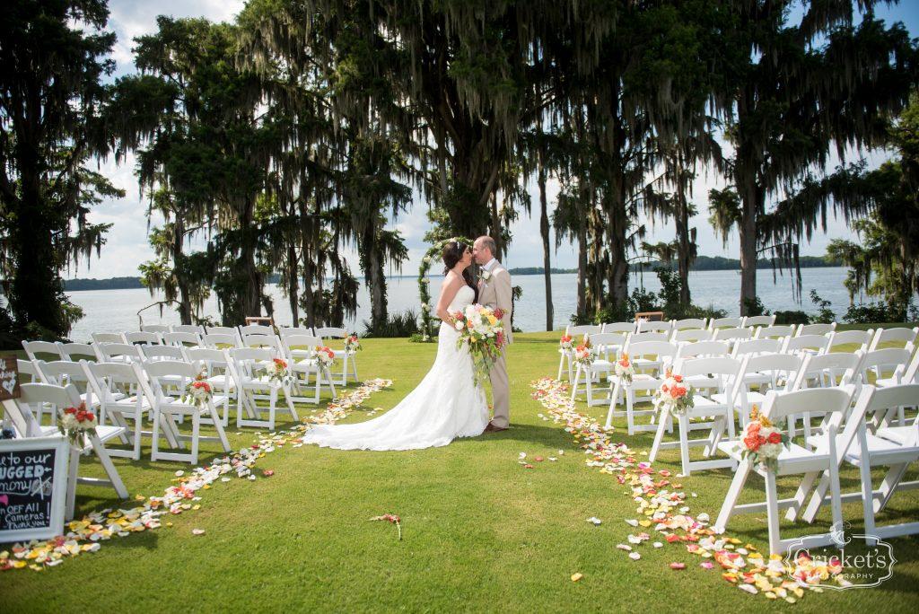 Bride & Groom Kissing Outdoor Ceremony |Travel Themed Inspired Wedding Mission Inn Resort Orlando Florida Anna Christine Events Cricket's Photo & Cinema