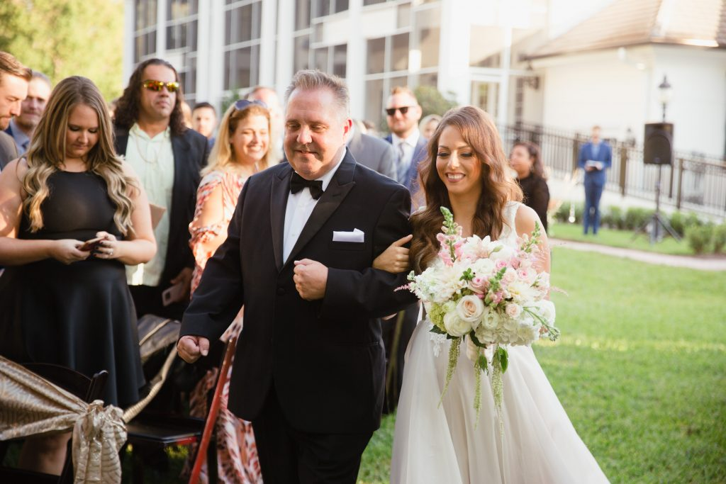 Bride Walking Down Aisle with Father | Travel Inspired Themed Glamorous Gold & White Wedding Luxmore Grande Estate Anna Christine Events Justin DeMutiis Photography